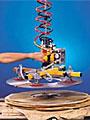 ANVER Vacuum Hoist Lifter Handles Coils without Mechanical Grabs