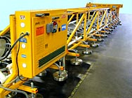 ANVER Electric Powered Vacuum Lifter with an overall length of 108 feet (42.5 m) and a total of 160 Vacuum Pad Suspensions  for Lifting Extra Long Very Porous Loads weighing up to 7000 lb (3180 kg)