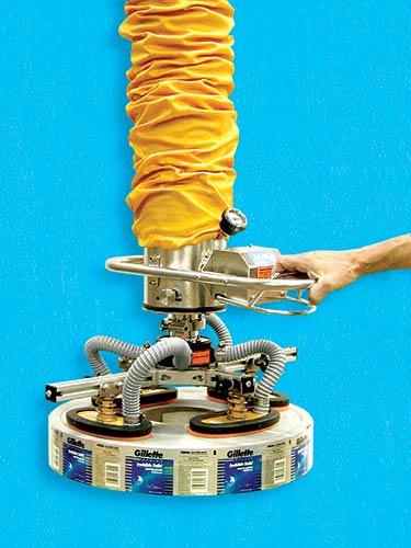 Vacuum Tube Lifting System with Round Pad Attachment for Lifting Rolls of Labels